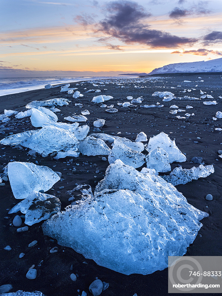 Iceberg on black vulcanic beach. North Atlantic beach of the ice lagoon Joekulsarlon at glacier Breithamerkurjoekull, Vatnajoekull NP. europe, northern europe, iceland, march