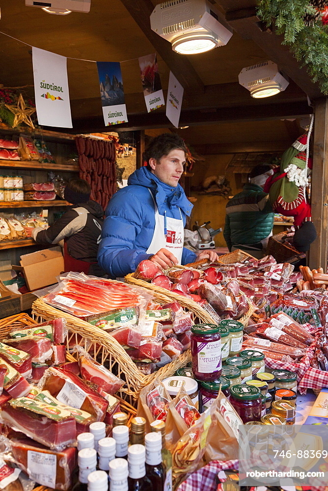The Christmas Market in Sterzing (Vipiteno) in the medieval historic center. Booth selling local meat products. Europe, Central Europe, Italy, South Tyrol, December