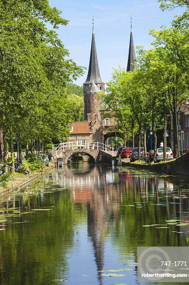Canal scene with bridge, 16th century East Port Gate Towers, Delft, Holland, Europe