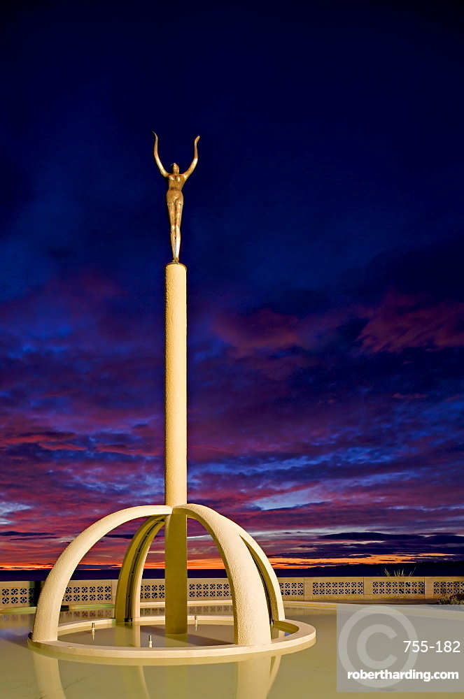 Art Deco statue at sunrise over the Pacific Ocean, Napier, North Island, New Zealand, Pacific