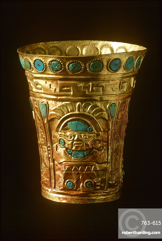 Precolumbian Gold Chimu Culture, 1000-1400AD drinking vessel of gold and turquoise, depicts idol with staff and headdress Museo del Oro, Lima, Peru
