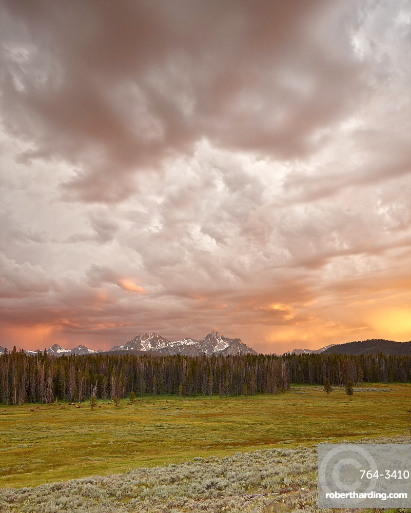 Orange clouds at sunset over The Sawtooth Mountains, Sawtooth National Recreation Area, Idaho, United States of America, North America
