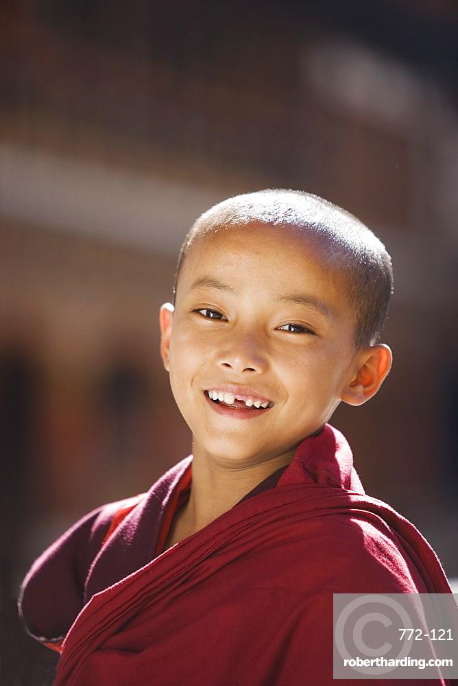 Young Buddhist monk, Paro Dzong, Paro, Bhutan, Asia