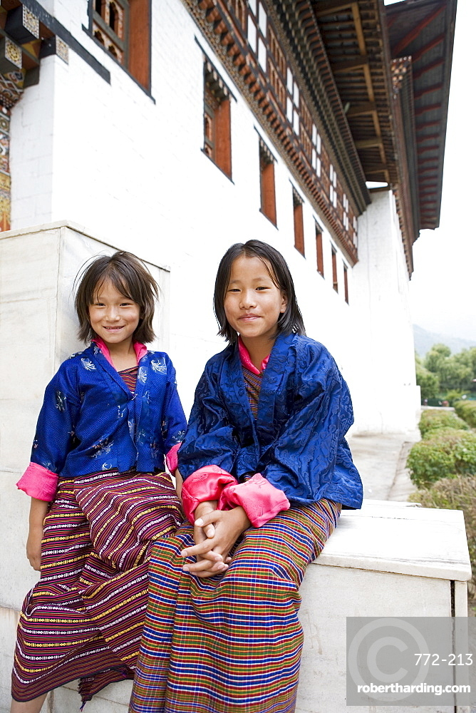 Pilgrims watching religious dances at Buddhist festival (Tsechu), Trashi Chhoe Dzong, Thimphu, Bhutan, Asia