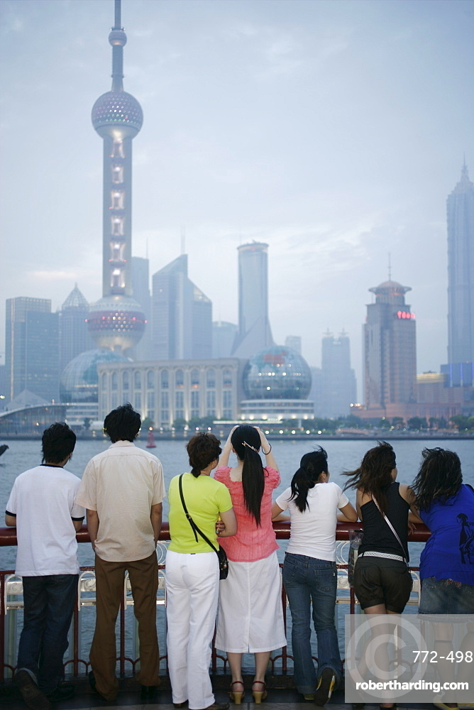 People on the Bund looking at the Oriental Pearl Tower in Pudong District, Shanghai, China, Asia