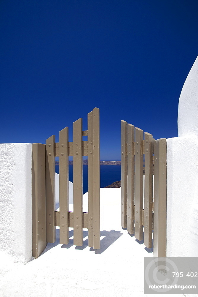 Open gate and view at Oia, Santorini, Cyclades, Greek Islands, Greece, Europe