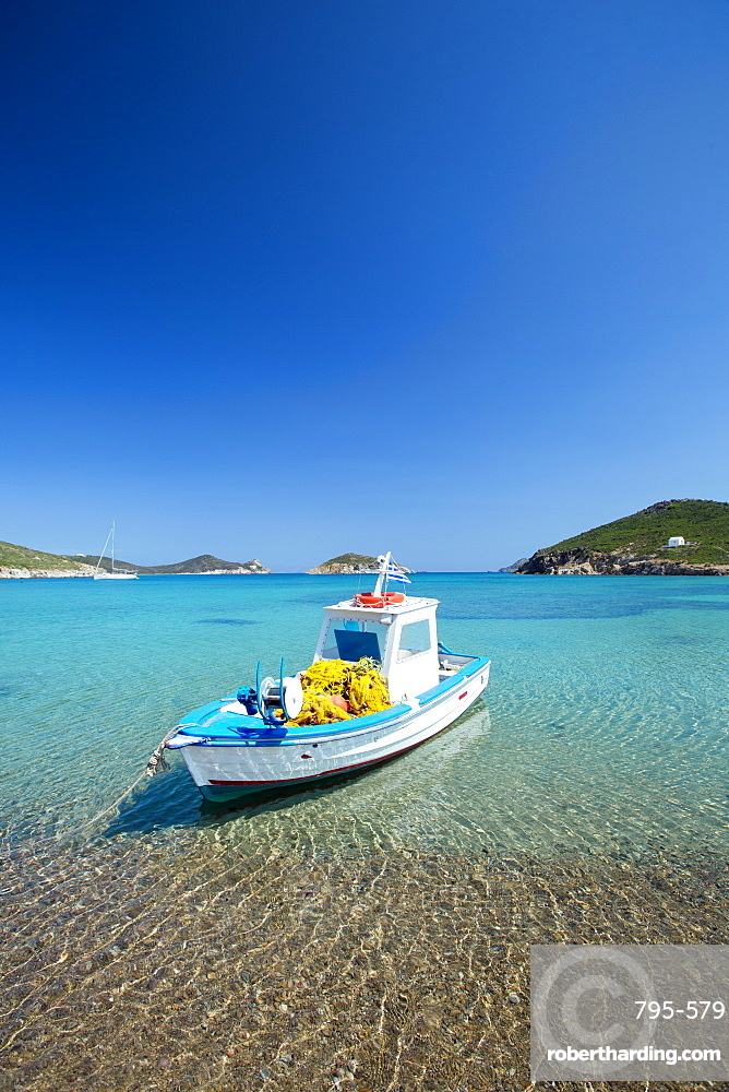 Fishing boat moored on the beach, Patmos Island, Dodecanese, Greek Islands, Greece, Europe