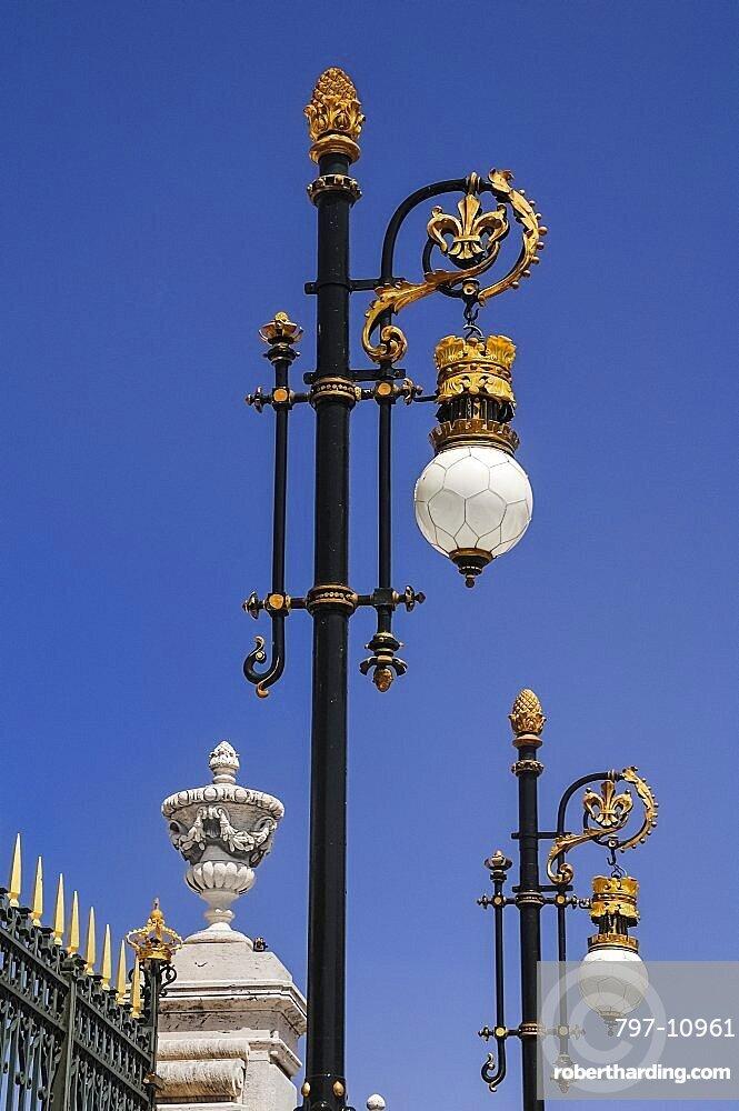 Spain, Madrid, Palacio Real ornate golden lamps at the entrance to the Royal Palace.