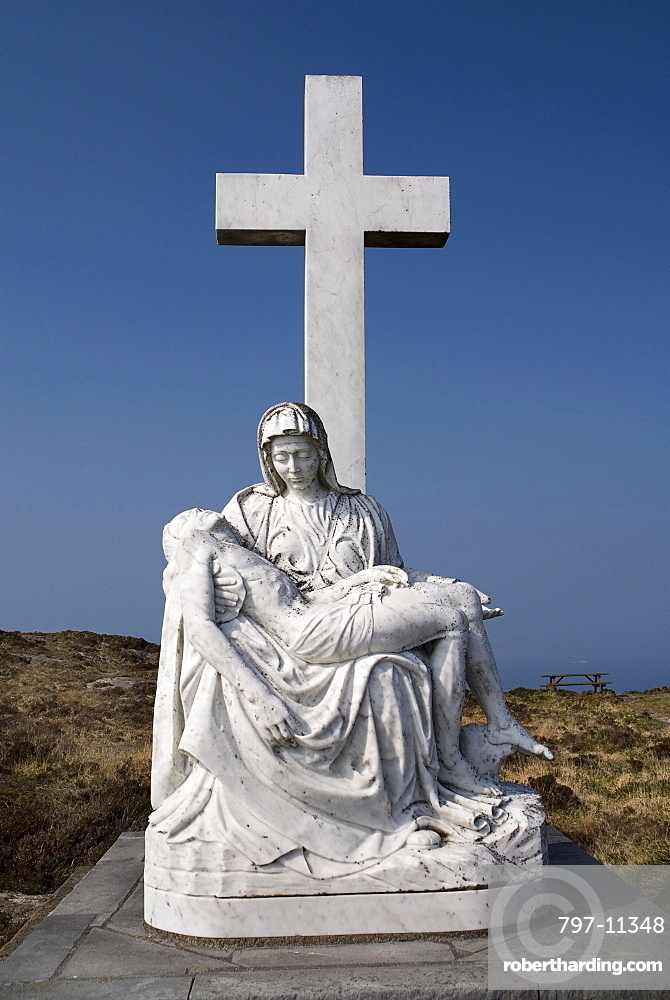 Ireland, County Cork, Sheeps Head Peninsula, Religious staue showing a Calvary scene.