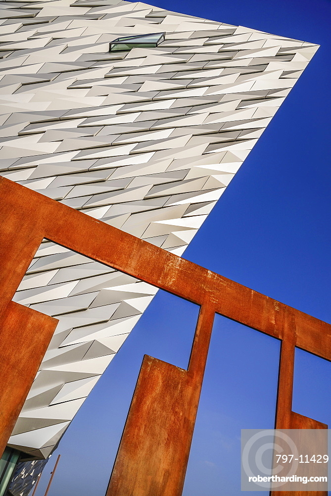 Ireland, North, Belfast, Titanic Quarter, Titanic Belfast Visitor Experience, Graphic shapes of a section of the building and the Titanic sign.