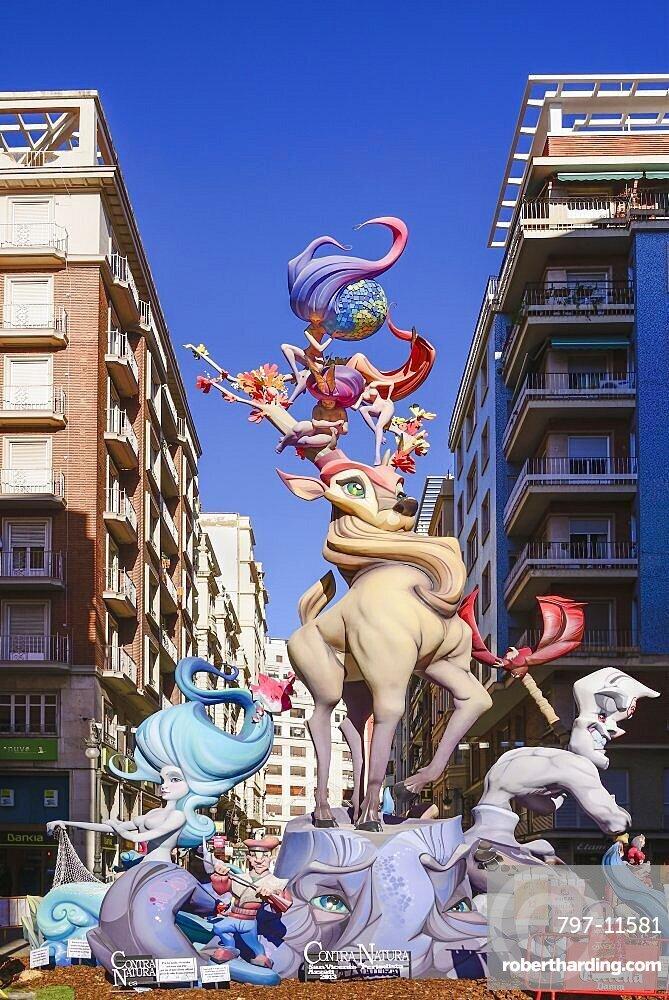 Spain, Valencia Province, Valencia, Typical falla scene with Papier Mache figures in the street during Las Fallas festival.
