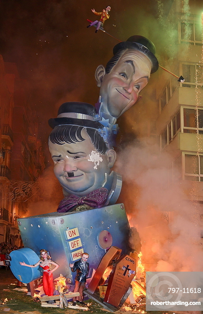 Spain, Valencia Province, Valencia, La Crema, The Burning of the Papier Mache figures in the street during Las Fallas festival on March 19th, Laurel and Hardy going up in flames.