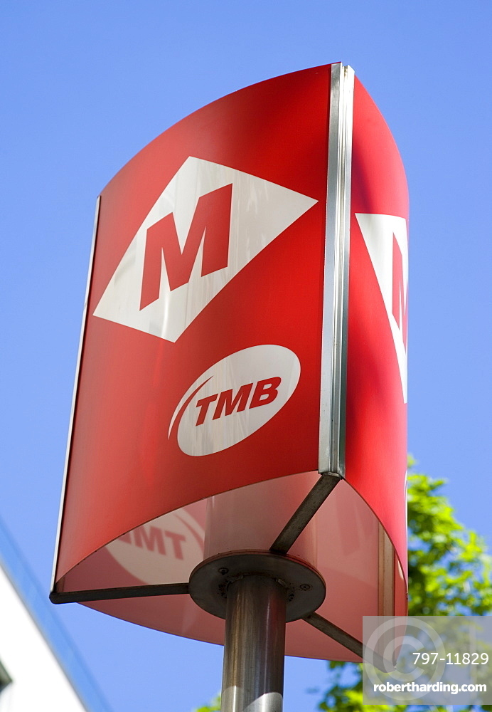 Spain, Catalonia, Barcelona, Red Metro sign against a blue sky.