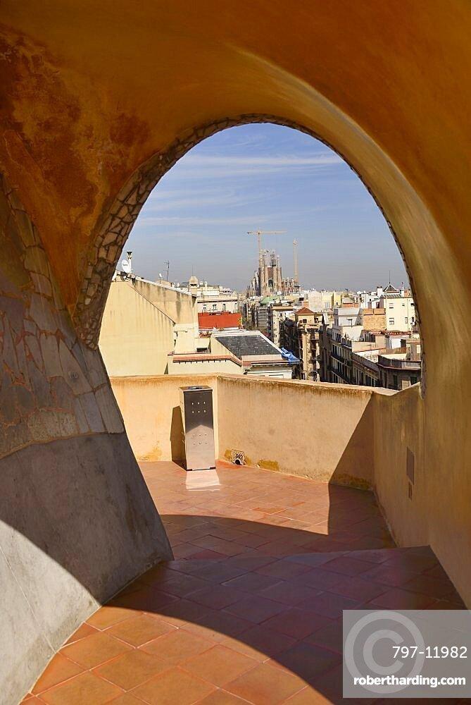 Spain, Catalunya, Barcelona, distant view of La Sagrada Familia from the rooftop of La Pedrera .