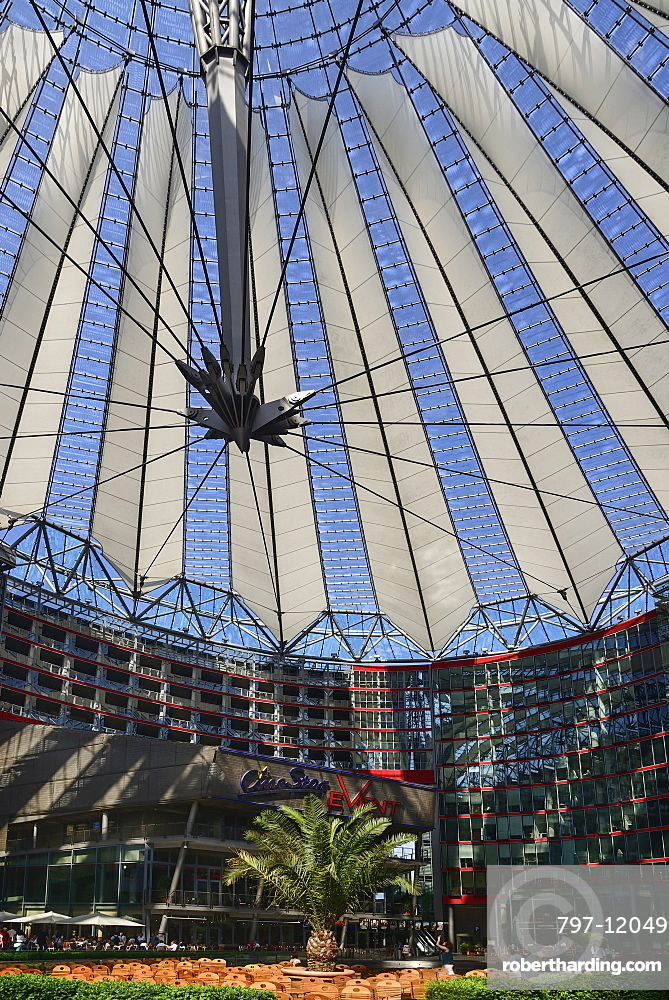 Germany, Berlin, Potzdamer Platz, Sony Centre with glass canopied roof over its central plaza.
