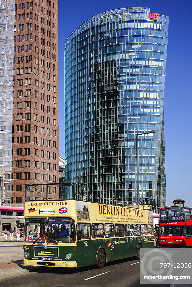 Germany, Berlin, Potzdamer Platz with Berlin City sightseeing tour bus in the foreground and Bahn Tower in the background.
