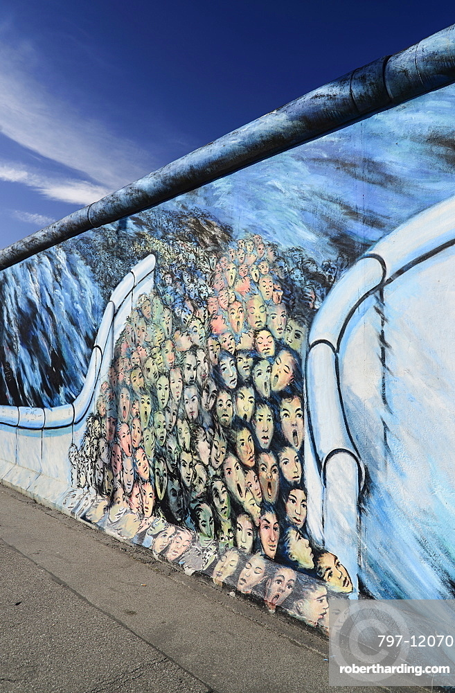 Germany, Berlin, The East Side Gallery, a 1.3 km long section of the Berlin Wall, Mural known as 'It happened in November' by Kani Alavi.