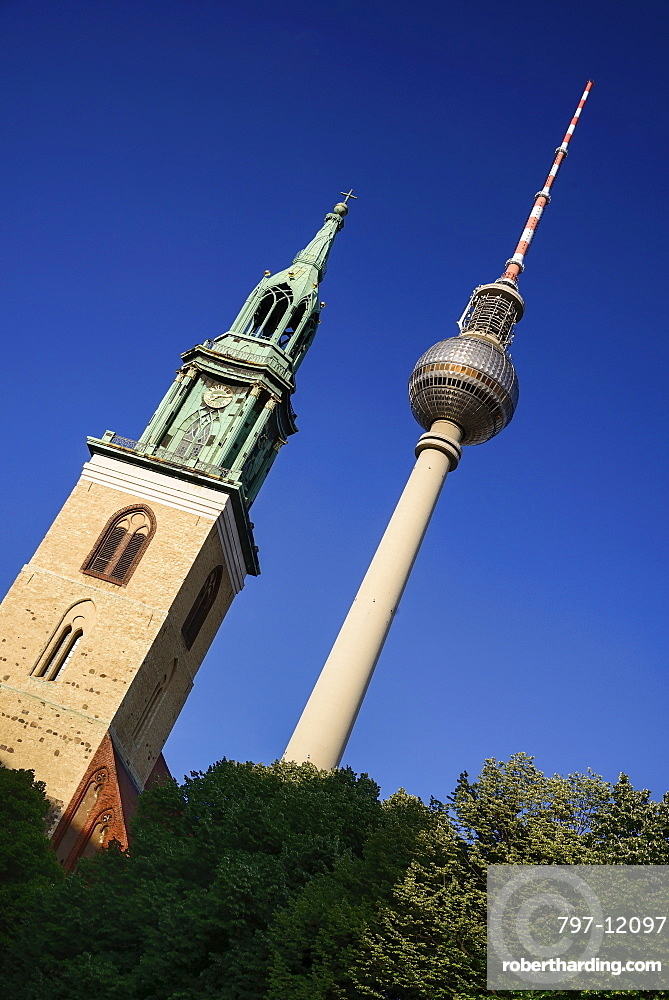 Germany, Berlin, Fernsehturm, Berlin's TV Tower overlooking Marienkirche also known as St Marys Church.