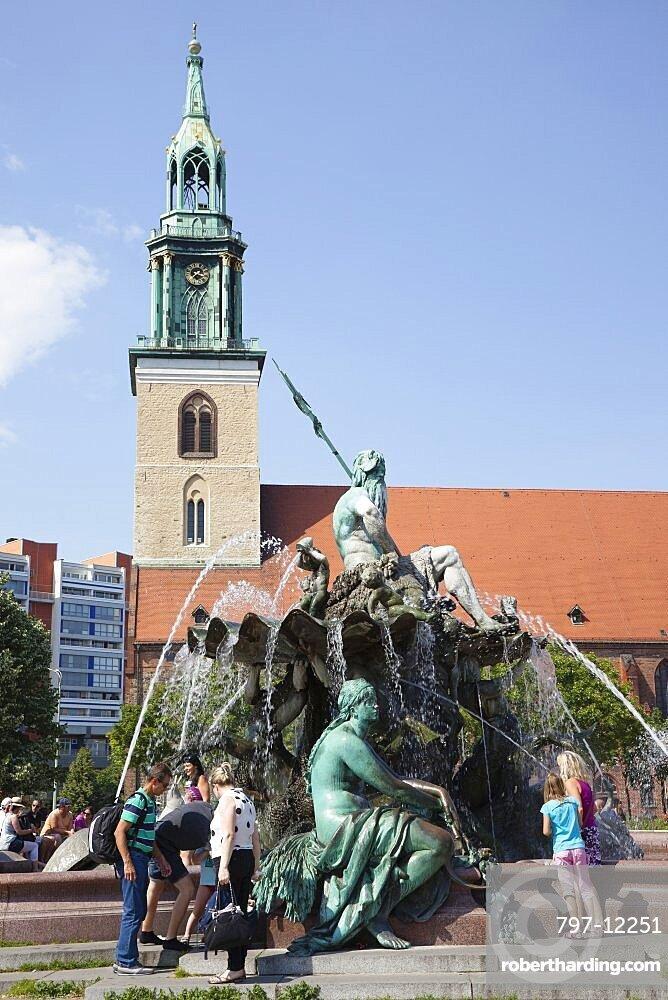 Germany, Berlin, Mitte, Neptunbrunnen fountain next to St Marienkirche in Alexanderplatz.