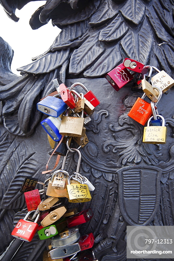Germany, Berlin, Mitte, Young couples attached initialled padlocks to the Freidrichstrasse bridge ove rthe river Spree.