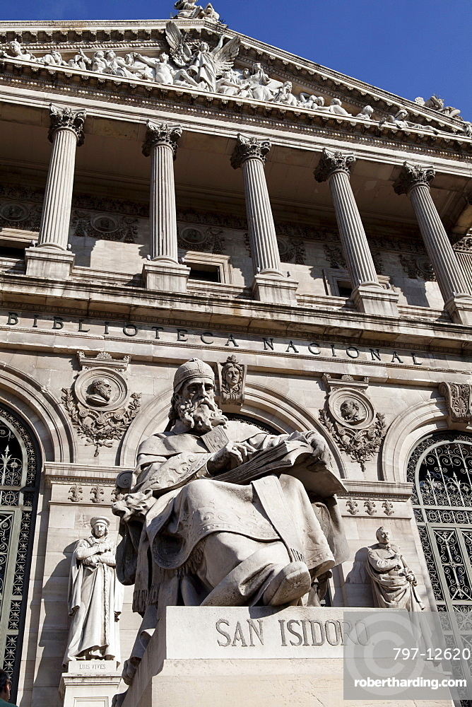 Spain, Madrid, Statue of San Isidoro on the steps of the National Library.