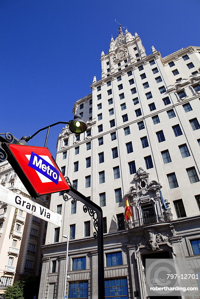 Spain, Madrid, Metro Sign outside Edificio Telefonica on Gran Via.