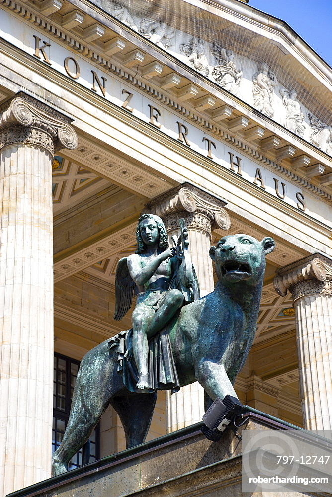 Germany, Berlin, Mitte, The Konzerthaus Concert Hall, home of the Berlin Symphony Orchestra, entrance portico with a bronze statue of a muse playing music seated on a panther.