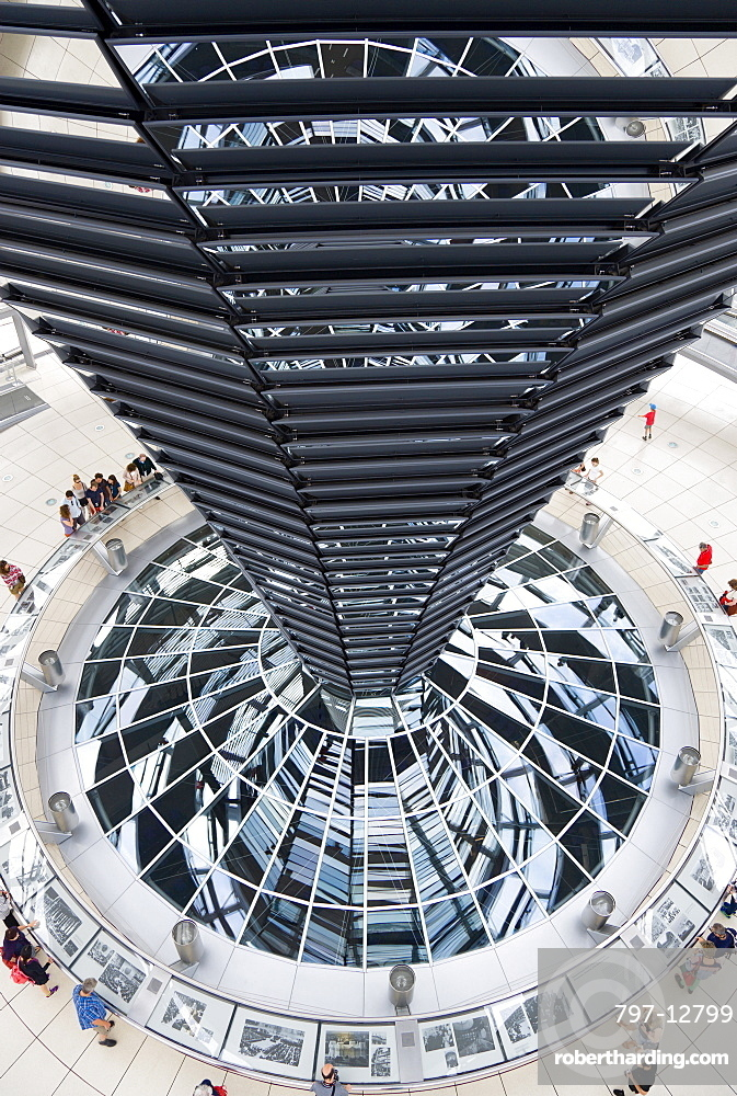 Germany, Berlin, Mitte, Tiergarten, interior of the glass dome on the top of the Reichstag building designed by architect Norman Foster with a double-helix spiral ramp around the mirrored cone that reflect light into the debating chamber of the Bundestag below.