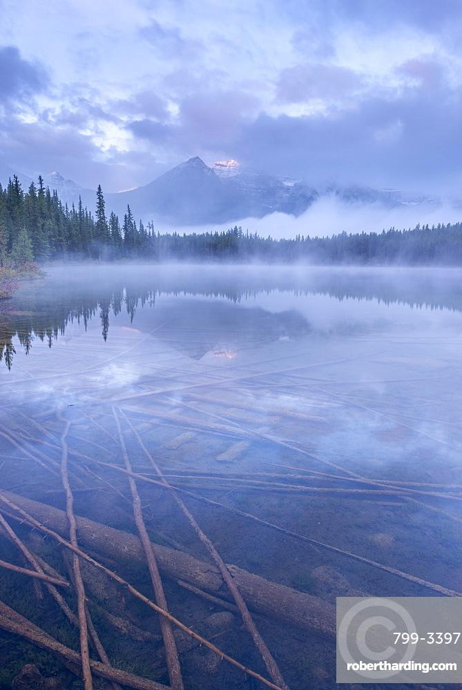 Atmospheric misty morning in the Canadian Rockies, Herbert Lake, Banff National Park, UNESCO World Heritage Site, Alberta, Canada, North America