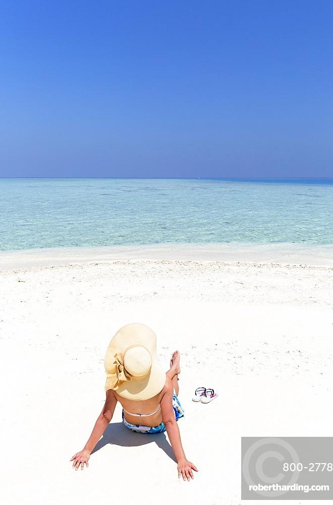 Woman on sandbank, Kaafu Atoll, Maldives, Indian Ocean, Asia