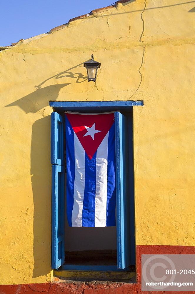 Cuban flag in doorway, Trinidad, UNESCO World Heritage Site, Sancti Spiritus, Cuba, West Indies, Central America