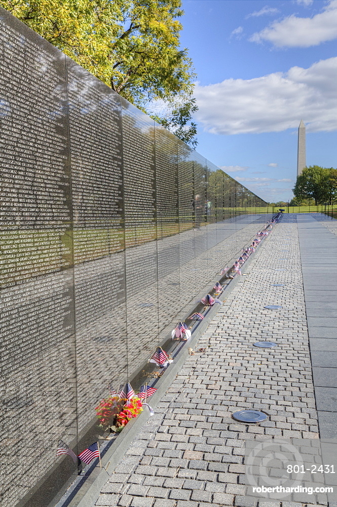 The Wall, Washington Monument in the background, Vietnam Veterans Memorial, Washington D.C., United States of America, North America