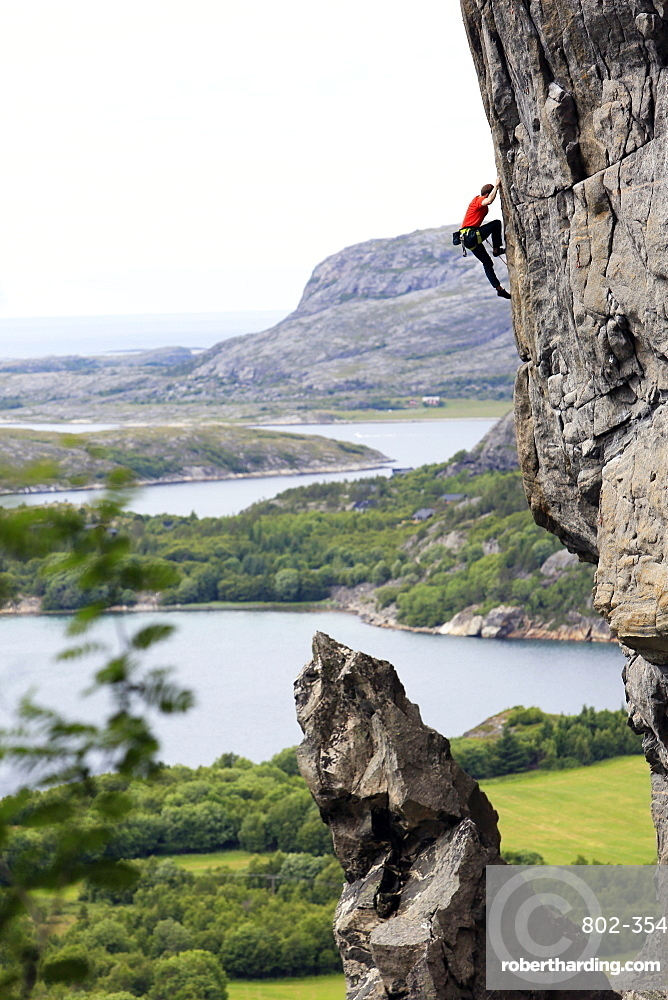 A climber scales a difficult route in the Hanshallaren Cave, Flatanger, Norway, Scandinavia, Europe