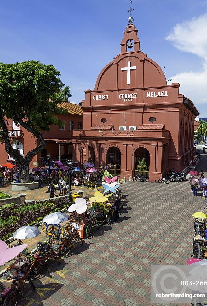 Rickshaws outside Christ Church in the town square, Melaka (Malacca), UNESCO World Heritage Site, Malaysia, Southeast Asia, Asia