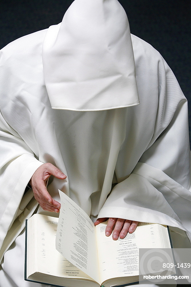 Monk reading the Bible, Evian, Haute Savoie, France, Europe