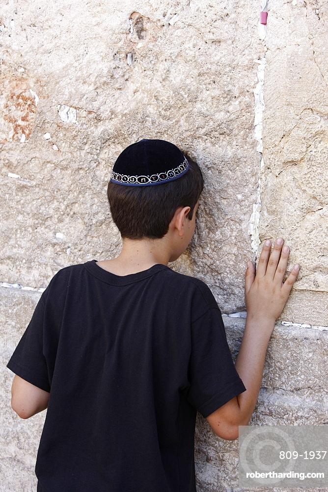Boy praying at the Western Wall, Jerusalem, Israel, Middle East