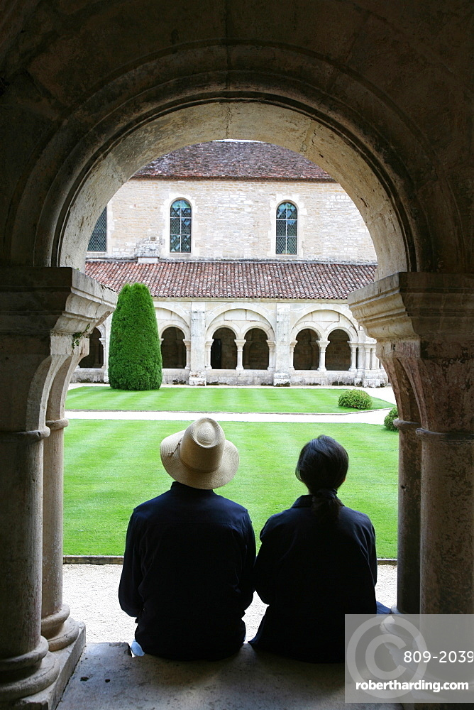 Tourists in Fontenay Cistercian Abbey cloister, UNESCO World Heritage Site, Marmagne, Doubs, Burgundy, France, Europe