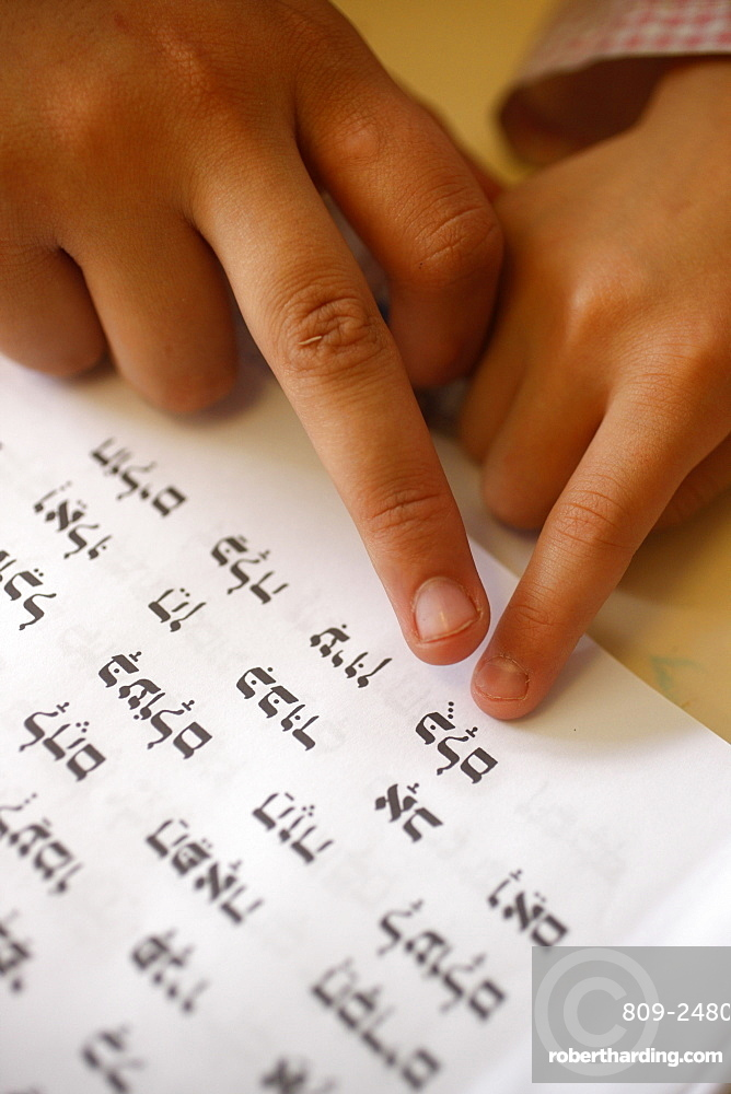 Child learning Hebrew in Jewish school, Paris, France, Europe