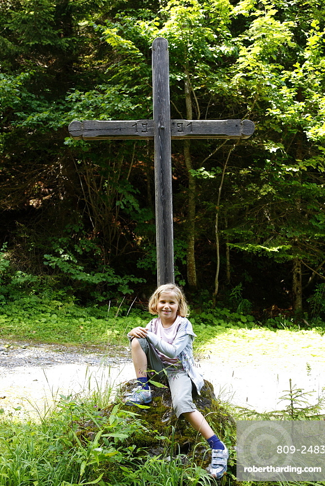 Child and cross, Saint-Gervais, Haute Savoie, France, Europe