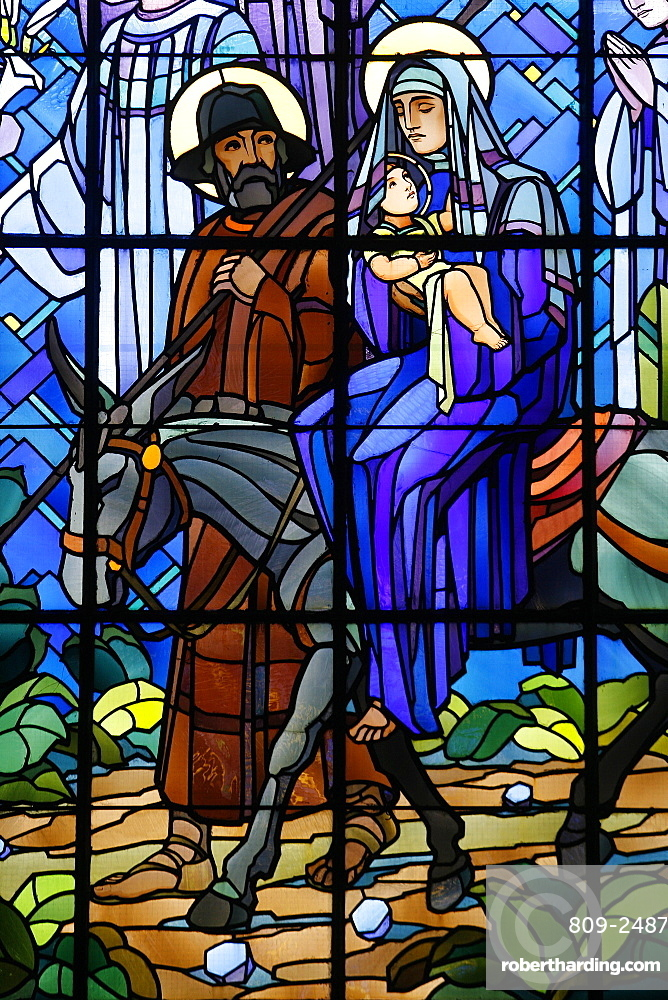 Stained glass window of the Flight into Egypt, in Chedde church, Haute Savoie, France, Europe
