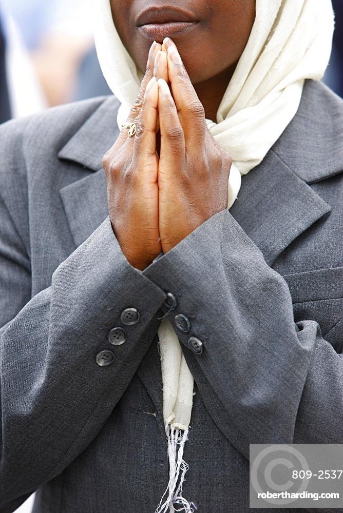 Praying woman, Paris, France, Europe