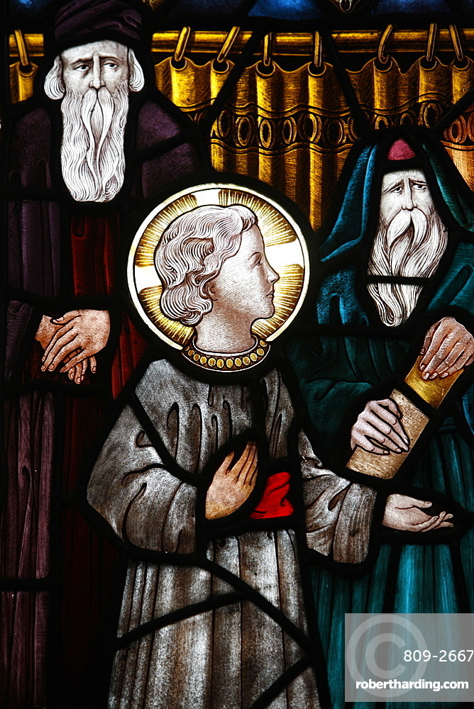 Jesus as a child in the temple with Mary and Joseph, 19th century stained glass in St. John's Anglican church, Sydney, New South Wales, Australia, Pacific