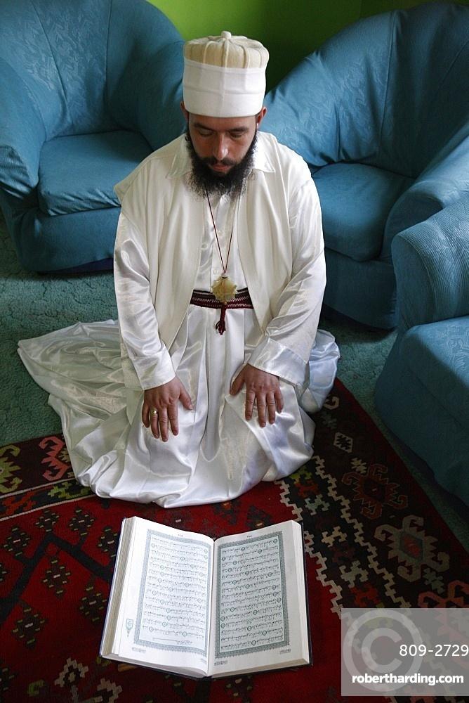 Bektachi dervish reading Koran, Tirana, Albania, Europe