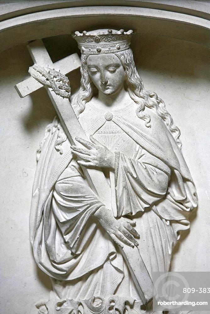 Sculpture of the crowned Virgin carrying a cross, Saint-Pierre de Solesmes Abbey, Solesmes, Sarthe, Pays de la Loire, France, Europe