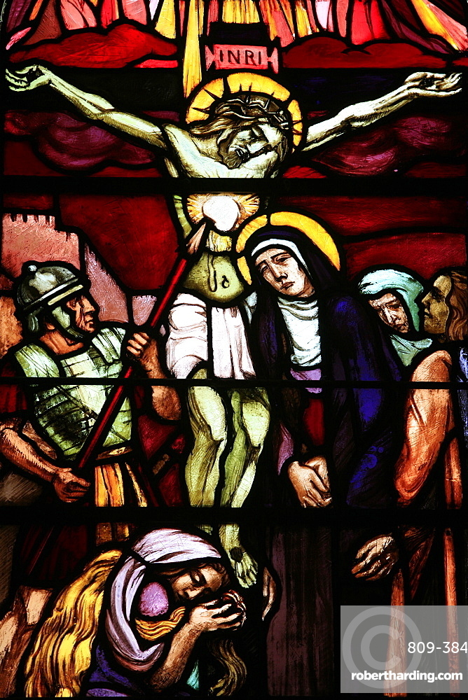 Stained glass of Christ on the cross, in Saint-Pierre de Solesmes Abbey, Solesmes, Sarthe, Pays de la Loire, France, Europe