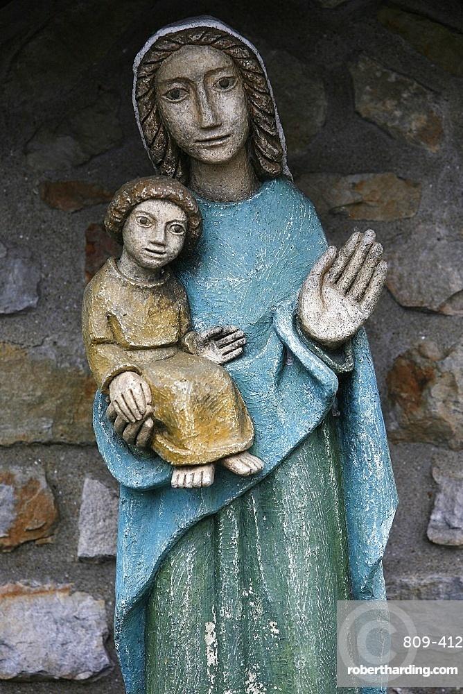 Statue of Virgin and Child outside Saint-Pierre de Solesmes Abbey, Solesmes, Sarthe, Pays de la Loire, France, Europe