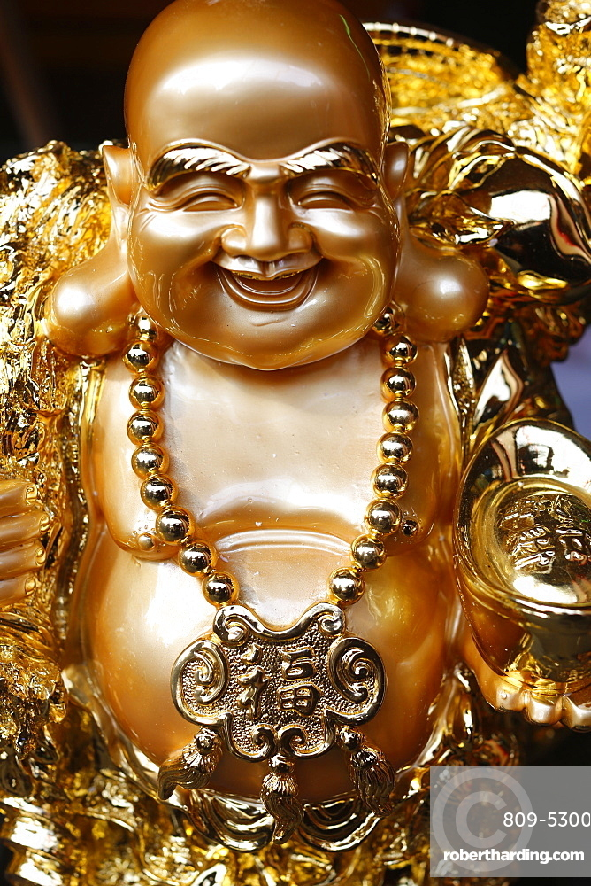 Statue of Ong Dia, the round happy God of the Earth who symbolizes prosperity, Paris, France, Europe