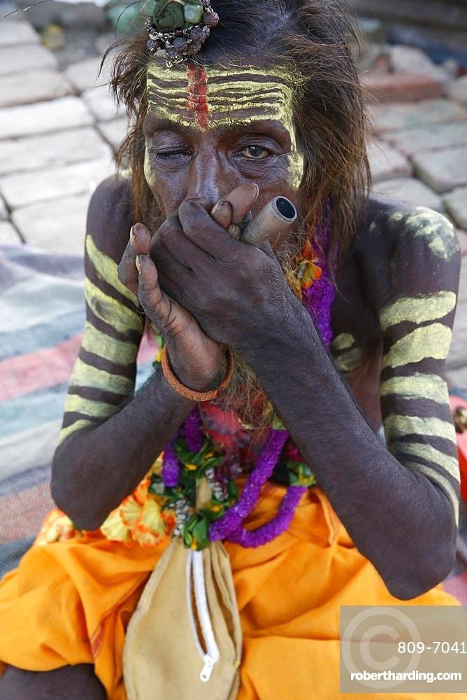 Indian sadhu smoking a chilum in Vrindavan, Uttar Pradesh, India, Asia