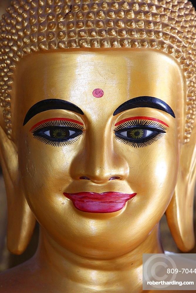 Close-up of a pink-lipped Buddha statue, Battambang, Cambodia, Indochina, Southeast Asia, Asia