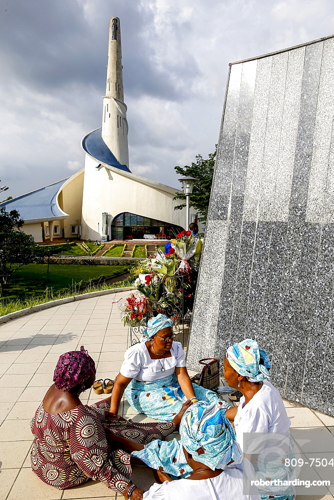 Pilgrims praying and joining hands at Our Lady of Africa Catholic sanctuary, Abidjan, Ivory Coast, West Africa, Africa